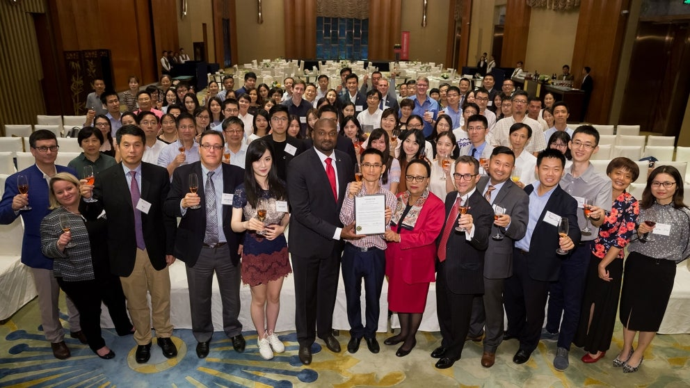 President Jackson poses with members of the RAA Shanghai Alumni Chapter