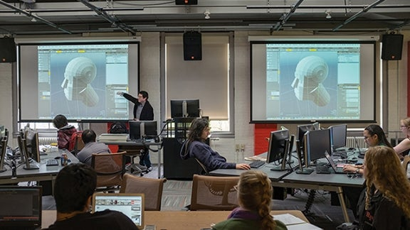 Students in a Games and Simulation Arts and Sciences (GSAS) class
