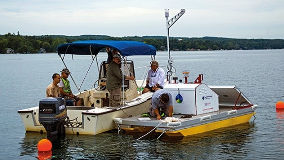 Scientists installing environmental monitoring system on Skaneateles Lake
