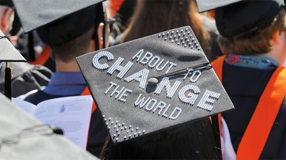 "Mortar board with ""About to Change the World"""