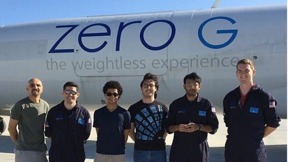 Professor Amir Hirsa and students in front of Zero G Airplane