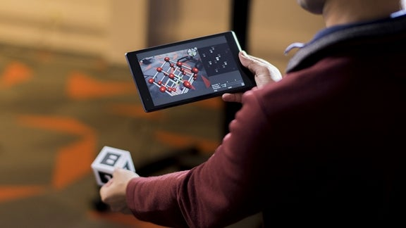 Man playing handheld video game