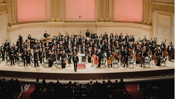 Rensselaer orchestra on stage performing at Carnegie Hall