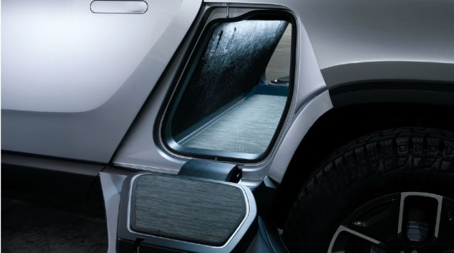 Pass through storage on Rivian is large enough for a surfboard